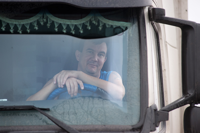 driver_in_cab_looking_through_glass